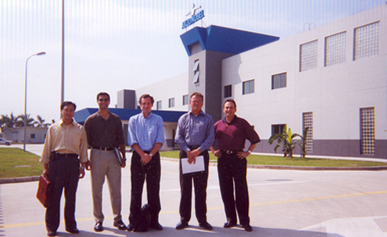 Raymond (left) and Ravin (2nd from left), along with Akzo Nobel executives at the Akzo Nobel Nonstick Coatings facility in China (2001).